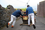 Europe, Portugal, Madeira. The Monte to Funchal toboggan ride in a wicker sleigh.
