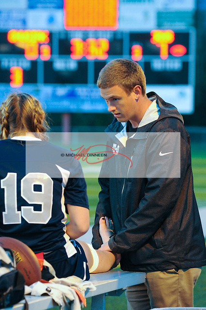 Bryan Beachem, BOC athletic trainer checks out Eagle River player Sierra Love's ankle during Friday night's game with Chugiak.  Photo for the Star by Michael Dinneen