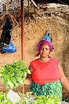 A woman selling lettuce at the street market near the ferry in Likoni, Kenya.