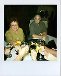 Carolyn Eberspecher toasts with her childhood friends (affectionately self-named 'The Ya-Yas') in the days leading up to her husbands move to the Douglas Care Center.  Her friends came to town to see her through the difficult transition....Alzheimers.  Douglas, Wyoming..Mike Eberspecher was diagnosed at 60 with early onset Alzheimers.  The disease, a subset of dimentia, gradually impairs the brain's ability to form new memories, simultaneously undoing connections that make up old memories.  Patients generally experience memory loss from the present, backwards.  Early onset Alzheimers tends to progress quicker in younger patients. ..Carolyn Eberspecher has been caring for her husband, Mike, for the last five years.  Over time, he has gradually lost his ability to care for himself and relies on her for most of his needs.  In April of 2010, Carolyn will place her husband in an Alzheimer's care unit in the town's nursing home.  .Carolyn Eberspecher attends church in Douglas, Wyoming.  Carolyn and Mike attend separate churches.  After Mike was diagnosed with Alzheimers, he returned to attending Mormon church, a tradition which had fallen by the wayside for most of his adult life.