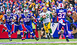 14 December 2014: Green Bay Packers quarterback Aaron Rodgers shambles for a 19 yard gain in the first quarter against the Buffalo Bills at Ralph Wilson Stadium in Orchard Park, NY. The Bills defeated the Packers 21-13, snapping the Packers' 5-game winning streak and keeping the Bills' 2014 playoff hopes alive. Mandatory Credit: Ed Wolfstein Photo *** RAW (NEF) Image File Available ***