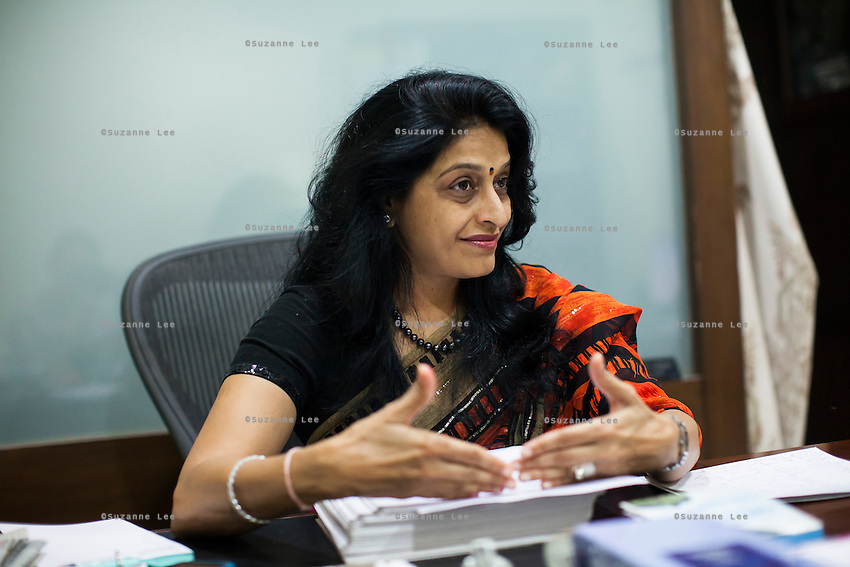Dr. Nayana Patel, sits at her desk in her Akanksha IVF and surrogacy center that she founded with her husband, Dr. Hitesh, in Anand, Gujarat, India on 11th December 2012. She had done her first successful surrogacy birth in 2003, and has delivered over 565 babies since the clinic's establishment. When choosing surrogates, they are counseled, and screened following a stringent guideline. Surrogates must be married and have completed their own families with their own children, and the couple must be medically, physically, psychologically, emotionally and mentally sound. While 15% of couples are infertile globally, only 6% of infertility cases require surrogacy as a last option. Photo by Suzanne Lee / Marie-Claire France