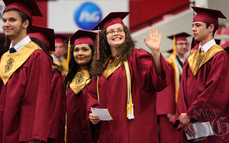 NWA Democrat-Gazette/DAVID GOTTSCHALK  Joann James, a graduating senior waves Wednesday, May 17, 2017, as she enters Barnhill Arena for graduation ceremonies of Rogers New Technology High School on the campus of the University of Arkansas in Fayetteville. The graduating class is the first to complete all four years at the school.