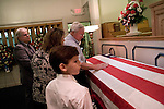 August 25, 2007. Kinston, NC.. A viewing of the coffin of Spc. Steven R. Jewell was held at Howard and Carter Funeral Home i Kinston, NC. Spc. Steven R. Jewell was killed in a helicopter crash  near the Iraqi city of Fallujah on August 14, 2007..  Jack Wisener, Spc. Jewell's stepfather, lays a hand on the coffin. His daughter Jacqueline Webster, is on his left.