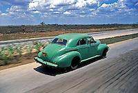 Classic American Vintage Car Speeding along Highway to Cienfuegos Cuba, Republic of Cuba,