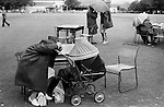 Village church summer fete villagers shelter from the rain. Gloucestershire England 1974