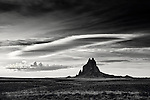 Adrift in a sea of desert, Shiprock rises to an altitude of 7,177' above sea-level. The desert plains of the Four Corners region in New Mexico.