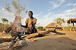 Jennifer Keji, a United Methodist, starts her day by cooking early in the morning in the Southern Sudan village of Kupera. Families here returned from refuge in Uganda in 2006 following the 2005 Comprehensive Peace Agreement between the north and south. NOTE: In July 2011, Southern Sudan became the independent country of South Sudan