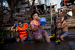 Kim Yen, 36, bathes with her two daughters, Yen, 4, left, and Thuy, 5, on the Hau Giang River, a tributary of the Mekong River, in Chau Doc, in the An Giang Province, Vietnam. When the Mekong River reaches Vietnam it splits into two smaller riveres. The &quot;Tien Giang&quot;, which means &quot;upper river&quot; and the &quot;Hau Giang&quot;, which means &quot;lower river&quot;. Photo taken on Monday, December 7, 2009. Kevin German / Luceo Images