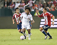 CARSON, CA – OCTOBER 9: Toronto FC midfielder Julian De Guzman (6) and Chivas USA players Paulo Nagamura (26) and Alan Gordon (16) during a soccer match at Home Depot Center, October 9, 2010 in Carson California. Final score Chivas USA 3, Toronto FC 0...