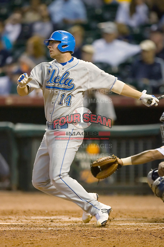 Casey Haerther #14 of the UCLA Bruins follows through on his swing versus the Rice Owls in the 2009 Houston College Classic at Minute Maid Park February 27, 2009 in Houston, TX.  The Owls defeated the Bruins 5-4 in 10 innings. (Photo by Brian Westerholt / Four Seam Images)