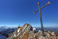 Cross anchored to rocks on summit of Mount Pilatus with Alps mountains in background, Switzerland