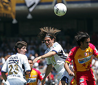 UNAM Pumas forward Bruno Marioni (C)  fights for the ball with UAG Tecos defender Juan Leano as his teammate Marco Antonio Palacios (L) looks on during their soccer match march 19, 2006 at the University Stadium in Mexico City. UAG Tecos won 1-0 to UNAM Pumas. Photo by © Javier Rodriguez