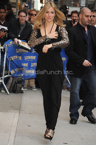 Sienna Miller at the Ed Sullivan Theater for an appearance on Late Show with David Letterman in New York City. October 13, 2009.. Credit: Dennis Van Tine/MediaPunch
