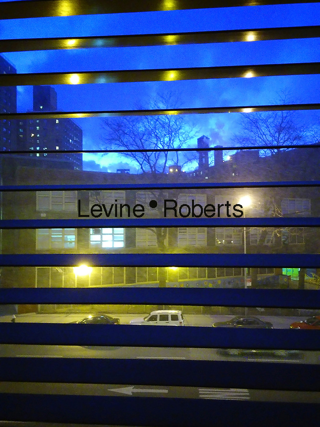 Sunset is seen in the Chelsea neighborhood of New York through venetian blinds in an apartment on Saturday, March 11, 2017.  (© Richard B. Levine)