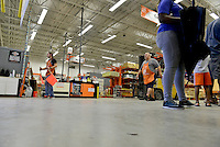 MIRAMAR, FL - OCTOBER 06: Home Depot employee bringing more Plywood as South Florida residents prepare for Hurricane Matthew by purchasing plywood at Home Depot on October 6, 2016 in Miramar, Florida. The hurricane is expected to make landfall sometime this evening or early in the morning as a possible category 4 storm.Credit: MPI10 / MediaPunch