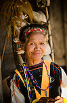 Woman in ceremonial dress in front of a traditional home, Luba Village, near Bajawa, Flores, East Nusa Tenggara, Indonesia