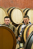 Frédéric Pourtalié, Domaine Montcalmes, right, and his cousin Vincent Guizard, Domaine Saint Sylvestre, in Puechabon. Terrasses de Larzac. Languedoc. Barrel cellar. Owner winemaker. France. Europe.