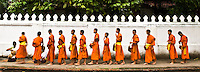 The monks accept offerings of food from devotees who believe that they