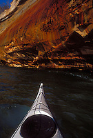 A sea kayaker explores the colored cliffs of Pictured Rocks National Lakeshore near Munising, Mich.