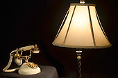 Vintage Telephone illuminated by an  Antique Lamp Stock photo