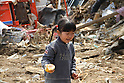 "March 29, 2011, Minamisanriku, Miyagi, Japan - More than two weeks after the tsunami the rural area between Kesennuma and Minamisanriku lies in ruin. ""I found a can of our food."" Says Saya Okoshi (6). (Photo by Wesley Cheek/AFLO) [3682]."
