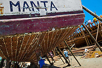 The stern of a traditional fishing wooden vessel is seen being repaired in an artisanal shipyard on the beach in Manta, Ecuador, 9 September 2012. The construction process takes 3-4 months to complete, depending on the ship size and purpose (fish capture methods). Although a wooden boat tends to be more stable on the sea and less expensive to build (up to $0.5 million USD), it needs a maintenance every 2 years, while a fiberglass-made boat, costing almost double the wooden one, may serve 5-6 years without any repairs. The shipyard produces 6-8 vessels every year.