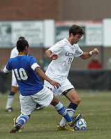 Creighton University midfielder Jose Gomez (10) disrupts University of Connecticut midfielder Colin Bradley (20)..NCAA Tournament. Creighton University (blue) defeated University of Connecticut (white), 1-0, at Morrone Stadium at University of Connecticut on December 2, 2012.