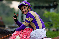 Rafael Bejarano gives his trademark peace sign after winning the Apple Blossom Stakes while riding Plum Pretty.
