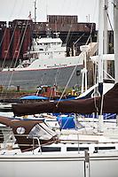 Pleasure boats and the freighter Michipicoten at Presque Isle Park in Marquette Michigan.
