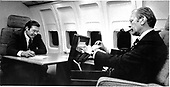 Travel time is working time for United States President Gerald R. Ford and Assistant Donald Rumsfeld as they study paperwork in a compartment aboard the Presidential airplane, Air Force One, on October 7, 1974.<br /> Mandatory Credit: David Hume Kennerly / White House via CNP