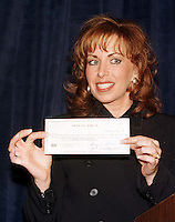 Paula Jones shows off the one million dollar check given to her by Abe Hirschfeld in an attempt to settle her sexual harassment lawsuit against United States President Bill Clinton at the Mayflower Hotel in Washington, DC on 31 October, 1998.<br /> Credit: Ron Sachs / CNP /MediaPunch