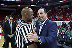 18 February 2017: Notre Dame head coach Mike Brey (right) with referee Sean Hull (left). The North Carolina State University Wolfpack hosted the University of Notre Dame Fighting Irish at the PNC Arena in Raleigh, North Carolina in a 2016-17 Division I Men's Basketball game. Notre Dame won the game 81-72.