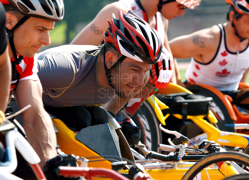 Rafael Jimenez of Spain (center) and Thomas Gerlach of Denmark (left) prepare for the start of a 10,000-meter run during the U.S. Paralympic Track & Field National Championships at Lakewood Stadium in Atlanta on Sunday, July 2, 2006. Over 200 athletes competed in this year's Paralympics, and many of them will be racing again in the Peachtree Road Race on Tuesday.