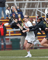 Boston College midfielder Sarah Mannelly (6) on the attack. .University of Maryland (black) defeated Boston College (white), 13-5, on the Newton Campus Lacrosse Field at Boston College, on March 16, 2013.