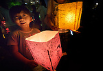 A boy carries a floating candle lantern on August 6, 2015, in Hiroshima, Japan. The lanterns, thousands of which were launched into a river on the 70th anniversary of the atomic bombing of the city, carry handmade messages and drawings, conveying each person's prayers for peace and comfort for the victims of the violence.