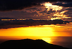 Mountain silhouetted against the clouds, sea and sunset in the south of Tenerife. Canary Islands.