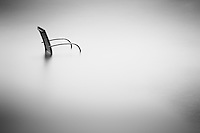 A lonely chair endures the tide in this long exposure. Taken at Mira Gut in Nova Scotia.