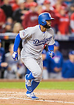 13 October 2016: Los Angeles Dodgers outfielder Andrew Toles hustles to first during the NLDS Game 5 against the Washington Nationals at Nationals Park in Washington, DC. The Dodgers edged out the Nationals 4-3, to take Game 5, and the Series, 3 games to 2, moving on to the National League Championship against the Chicago Cubs. Mandatory Credit: Ed Wolfstein Photo *** RAW (NEF) Image File Available ***