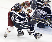 Maggie Hunt (UNH - 12), Danielle Welch (BC - 17), Kayley Herman (UNH - 31) - The Boston College Eagles and the visiting University of New Hampshire Wildcats played to a scoreless tie in BC's senior game on Saturday, February 19, 2011, at Conte Forum in Chestnut Hill, Massachusetts.