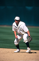 OAKLAND, CA - Jason Giambi of the Oakland Athletics plays defense at first base during a turn back the clock game against the San Francisco Giants at the Oakland Coliseum in Oakland, California on June 3, 2000. Photo by Brad Mangin