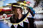 Yuri Campos poses for a portrait in her Stockton, Calif. party supply store, July 11, 2012. Campos lost her home to foreclosure, witnessed a murder, and is considering moving away. The bankrupt city has cut back on many services, incuding police services, leading to a skyrocketing crime rate.