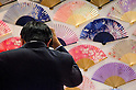 February 8th, 2012 : Tokyo, Japan &ndash; Colorful Japanese paper fans are displayed for The 73rd Tokyo International Gift show 2012 at Tokyo Big Sight. There are over 3 million items including gift products and everyday goods. 2500 exhibitors showcase their unique products. This exhibition is held from February 8 to 10. (Photo by Yumeto Yamazaki/AFLO).