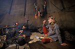 TeePee  people smoking a peace pipe in Welsh Hippie community Wales. TEPEE VALLEY NEAR LLANDEILO WALES  Circa 1985<br />