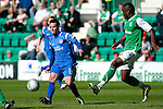 Hibs v St Johnstone.....30.04.11.Kevin Moon is closed down by Francis Dickoh.Picture by Graeme Hart..Copyright Perthshire Picture Agency.Tel: 01738 623350  Mobile: 07990 594431