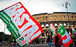ITALY, ROME, November 5, 2011..Italy demonstrators of the Centre-left party (Democratic Party) carries a banner while they take part in a rally against the government of Italian P.M. Silvio Berlusconi in Rome November 5 , 2011. VIEWpress / Kena Betancur.Italy's P.M. Berlusconi resigned on Saturday after new budget law is approved in parliament. The approval of the package will mark the final of the Berlusconi government..Local Media Report