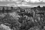 A castle set amongst woodland in England