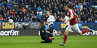 Bolton Wanderers' Adam Le Fondre sees his shot pushed to safety by Northampton Town's Adam Smith<br /> <br /> Photographer Alex Dodd/CameraSport<br /> <br /> The EFL Sky Bet League One - Bolton Wanderers v Northampton Town - Saturday 18th March 2017 - Macron Stadium - Bolton<br /> <br /> World Copyright &copy; 2017 CameraSport. All rights reserved. 43 Linden Ave. Countesthorpe. Leicester. England. LE8 5PG - Tel: +44 (0) 116 277 4147 - admin@camerasport.com - www.camerasport.com