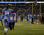Kentucky Wildcats wide receiver Aaron Boyd (27) walks off the field after the senior ceremony before the UK Football game v. Samford at Commonwealth Stadium in Lexington, Ky., on Saturday, November 17, 2012. Photo by Genevieve Adams | Staff