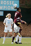 28 November 2008: Texas A&M's Rebecca Herrera (9) heads the ball in front of North Carolina's Allie Long (21). The University of North Carolina Tar Heels defeated the Texas A&M University Aggies 1-0 in double overtime at Fetzer Field in Chapel Hill, North Carolina in a Fourth Round NCAA Division I Women's college soccer tournament game.